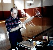 Bob Kochersperger tweaking his Manhattan indoor model aircraft