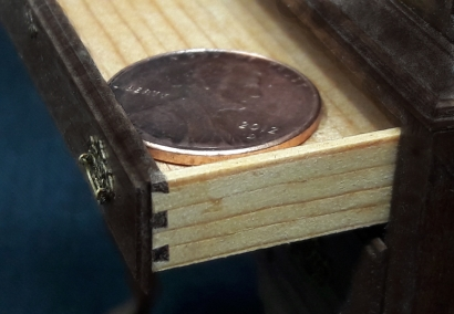 Shown here is a closeup shot of the tiny dovetail joint detail of one of the drawer corners. Incredibly, all of the corners of all of the drawers received the same treatment.