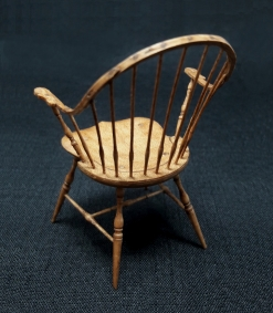 Emil explained that he used plans for a full sized Winsor chair to produce this minuature. The spindles were painstakingly made on a very small lathe. Not a simple task!