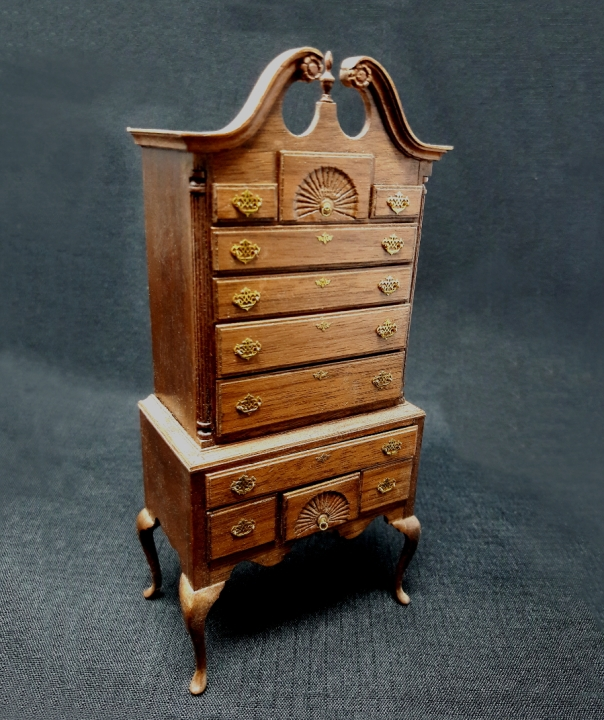 One of the many fine examples of Emil's miniature furniture. One can't even imagine the number of hours needed as well as the skills necessary to produces a masterpiece like this.