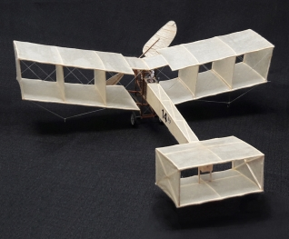 In 1906 Santos-Dumont designed the first French airplane, a lightweight box-kite plane 14-bis, built for him by the Voisin brothers. The 14-bis pioneered wheeled landing gear, and in 1906, became the first airplane to fly in public (leading many to believe that Santos-Dumont had achieved the first successful airplane flight). It flew brief hops, under moderate control, and was promptly hailed throughout Europe as the first successful airplane (the Wright's secretive achievements, not yet validated by any independent, internationally recognized authority, were not yet widely believed outside the United States, until the Wrights' 1908 European tour). Even after the Wrights performed in Europe in 1908, Santos-Dumont's 14-bis was widely regarded as the first European plane to fly under human control.
