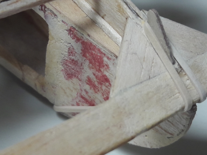 """This tab—made of 1/32"""" plywood—was added to the rear of the stab to act as the hold down """"hook""""."""